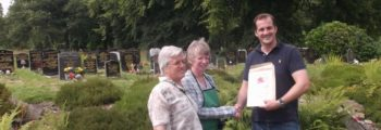 Anne is awarded with a 'pat on the back'